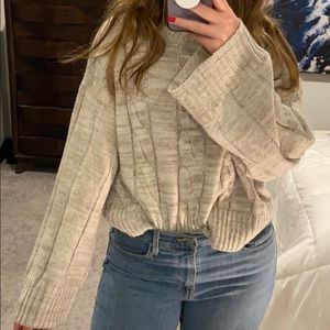 Wide sleeve cable knit
